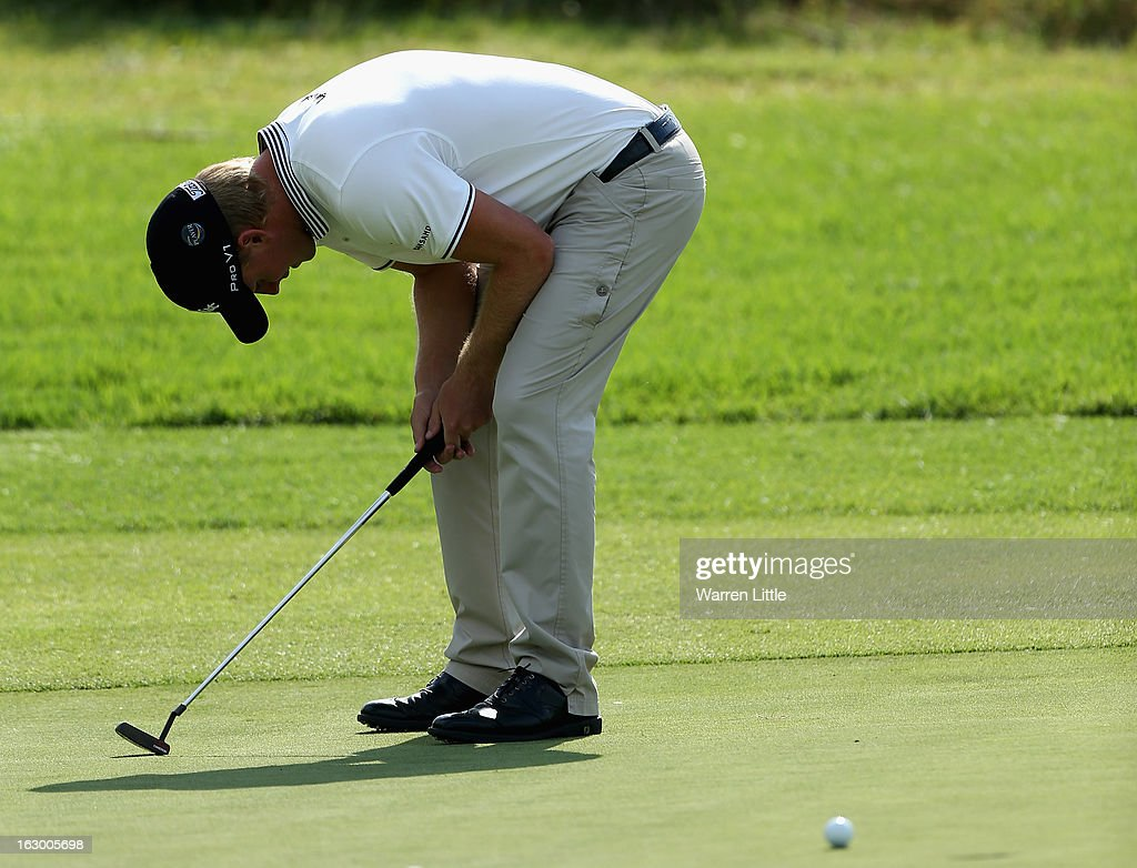 Morten Orum Madsen of Denmark reacts to a missed birdie putt on the 18th green during the final round of the Tshwane Open at Copperleaf Golf & Country Estate on March 3, 2013 in Centurion, South Africa.