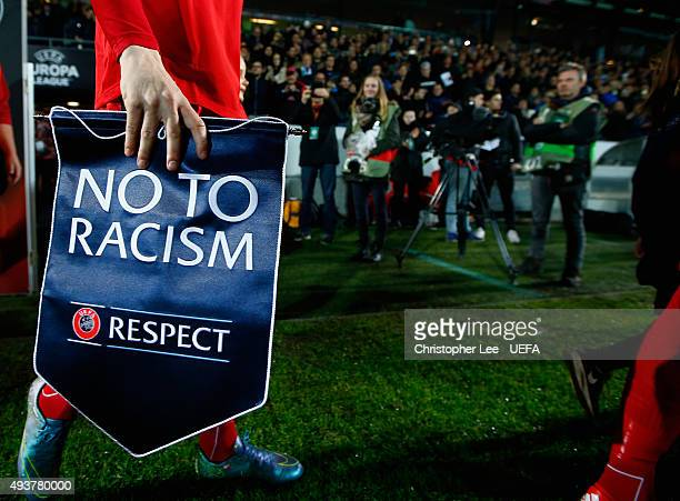 Morten Rasmussen of FC Midtjylland walks out onto the pitch with a No to Racism pennant during the UEFA Europa League Group D match between FC...