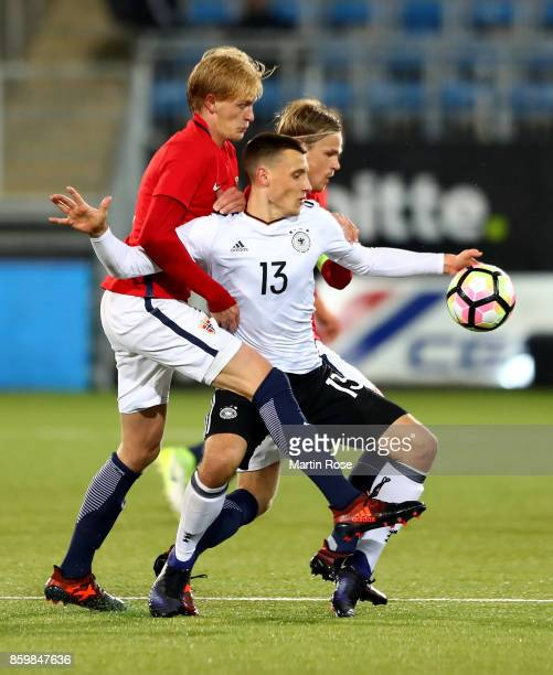 Morten Thorsby of Norway and Maximilian Eggestein of Germany battle for the ball during the UEFA Under21 Euro 2019 Qualifier match between U21 of...