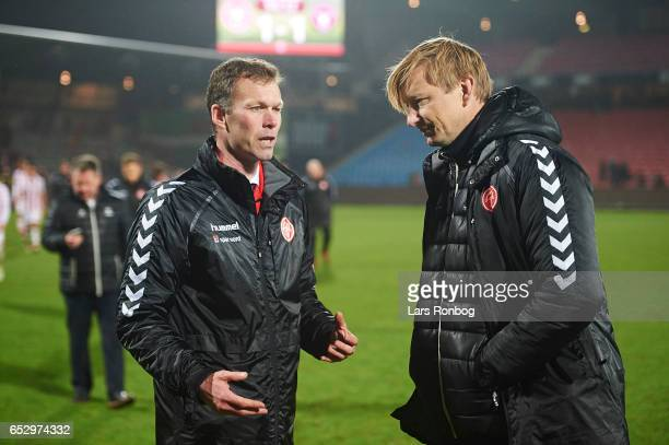 Morten Wieghorst head coach of AaB Aalborg speaks to Allan Gaarde sports director of AaB Aalborg after the Danish Alka Superliga match between AaB...