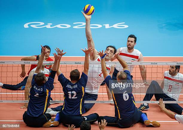 TOPSHOT Morteza Mehrzadselakjani IRI jumps for the ball at their Men's Gold Medal Match against Bosnia of Sitting Volleyball at the Riocentro...