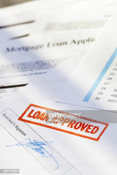 """Mortgage Application Document with Red """"Loan Approved"""" Approval Rubber Stamp"""