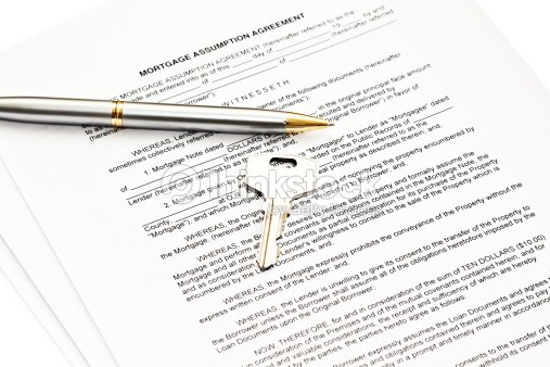 Mortgage Assumption Agreement With A Pen For Signature And Key Stock