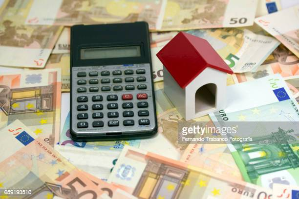 Mortgage. Buying a house with lots of money and calculator