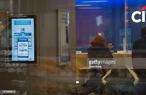 Mortgage rates are displayed inside a Citibank branch in New York US on Tuesday Nov 12 2013 US The Mortgage Bankers' Association's mortgage...