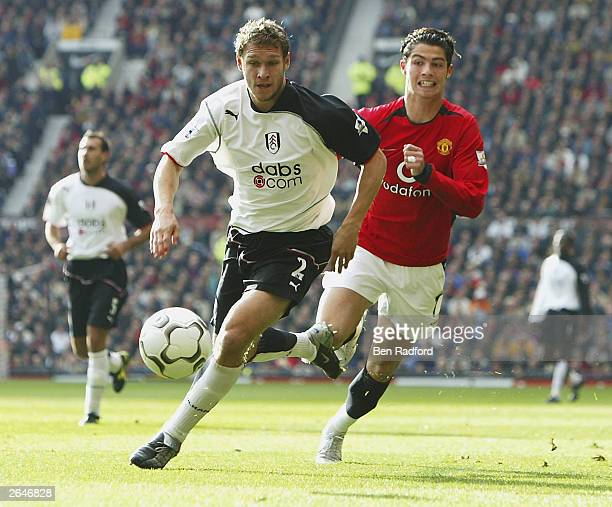 Mortiz Volz of Fulham holds Cristano Ranaldo of United during the FA Barclaycard Premiership match between Manchester United and Fulham at Old...