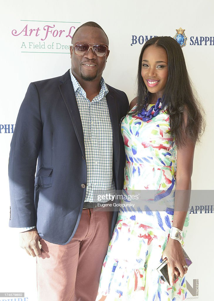 DJ Mos and DJ KIss attend the Russell Simmons 14th Annual Art For Life Benefit Sponsored By BOMBAY SAPPHIRE Gin at Fairview Farms on July 27, 2013 in Bridgehampton, New York.
