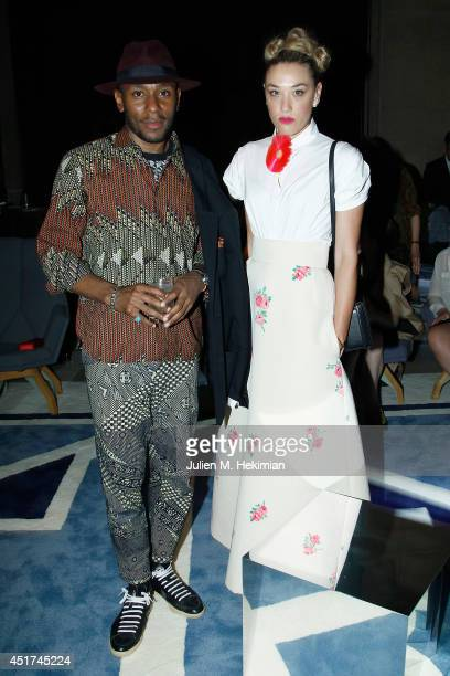 Mos Def and DJ Mia Moretti attend the Miu Miu Resort Collection 2015 at Palais d'Iena on July 5 2014 in Paris France