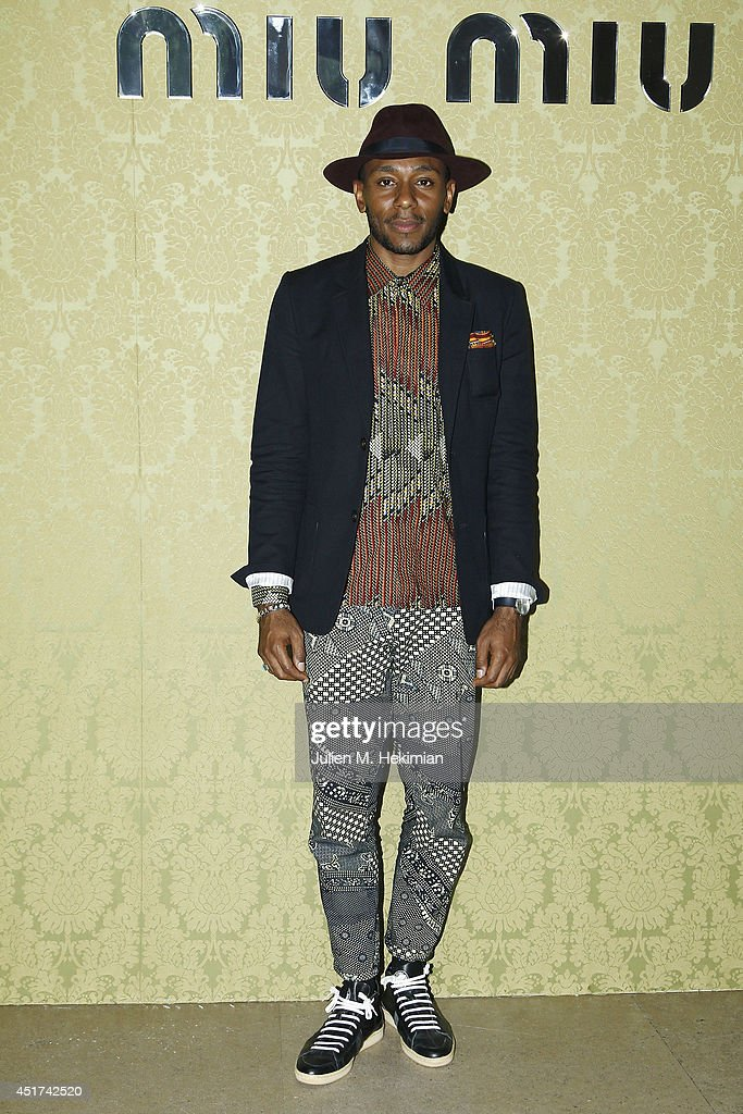 <a gi-track='captionPersonalityLinkClicked' href=/galleries/search?phrase=Mos+Def&family=editorial&specificpeople=206384 ng-click='$event.stopPropagation()'>Mos Def</a> attends the Miu Miu Resort Collection 2015 at Palais d'Iena on July 5, 2014 in Paris, France.
