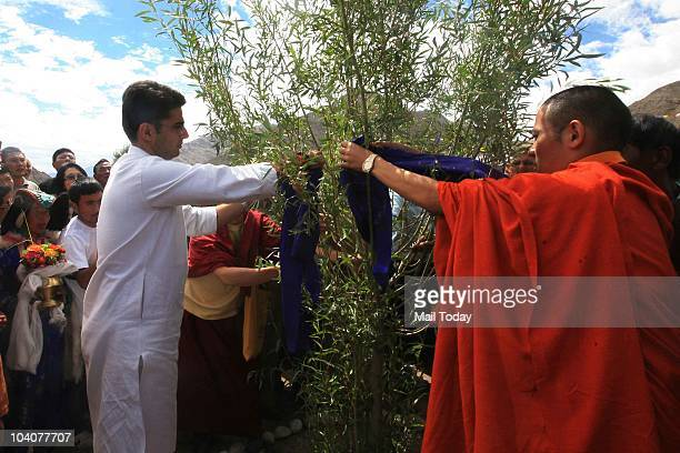 MoS for Communication and IT Sachin Pilot along with Kyabje Thuksey Rinpoche waters a plant during the 'Planting on the World's Rooftop' campaign...