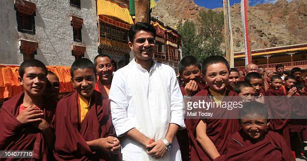 MoS for Communication and IT Sachin Pilot poses for a photograph with monks during a press conference after a tree plantation programme 'Planting on...