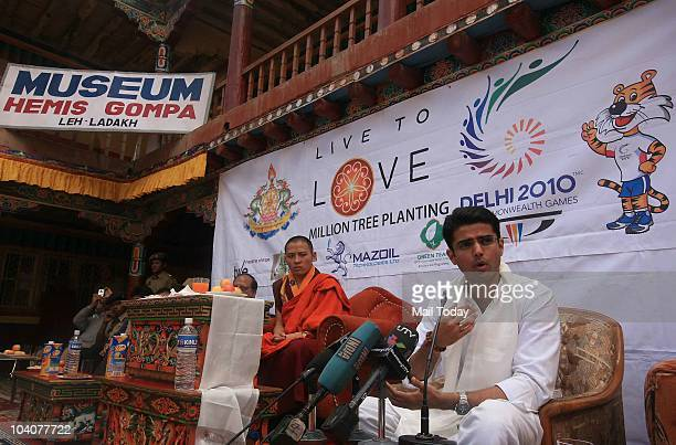 MoS for Communication and IT Sachin Pilot receives a memento from Kyabje Thuksey Rinpoche during a press conference after a tree plantation programme...