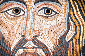 Mosaic representing Christ's Face, in byzantine style. Golden background. It is modern, made by a Sicilian artist, and looks like the Blessing Christ of the Monreale Cathedral or Cefalu' one. The back