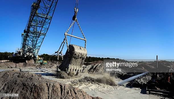 A Mosaic Co dragline dumps phosphate matrix into a slurry pond in Tampa Florida US on Friday Dec 2 2011 Mosaic Co is the world's largest producer of...