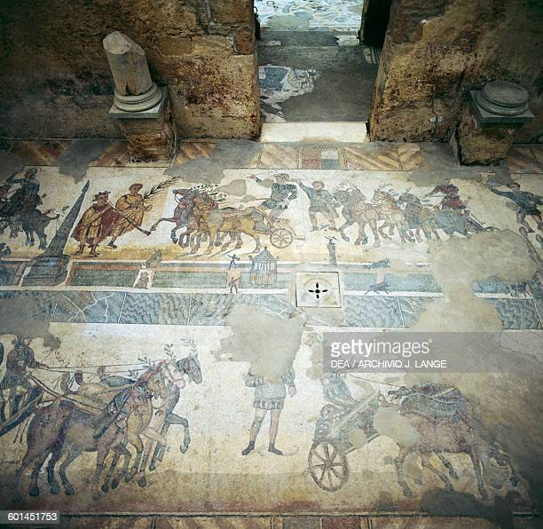 Mosaic floor depicting the Quadriga race in the Circus maximus from the palaestra Villa Romana del Casale Piazza Armerina Sicily Italy Roman...