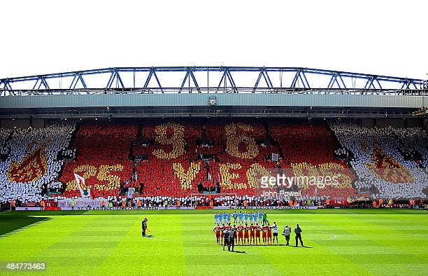 A mosaic is displayed by fans on the Kop as the two teams hold a minute's silence in honour of the 25th anniversary of the Hillsborough tragedy...