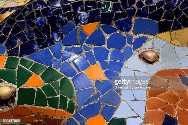 Mosaic lizard at Antoni Gaudi's Parc Guell Barcelona Spain Park Güell is a garden complex with architectural elements situated on the hill of El...