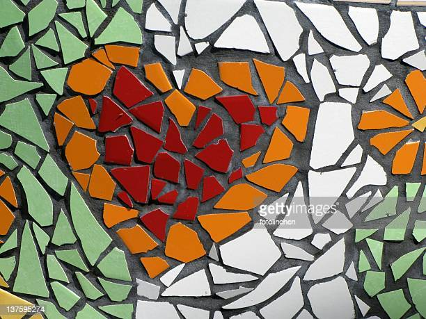 Mosaic of a red and orange heart on green and white tile