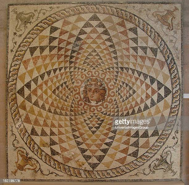 Mosaic of a Roman villa decorated with geometric motifs and Dionysius head with fruit and ivy in hIs hair in the center Pitchers with ivy in the...