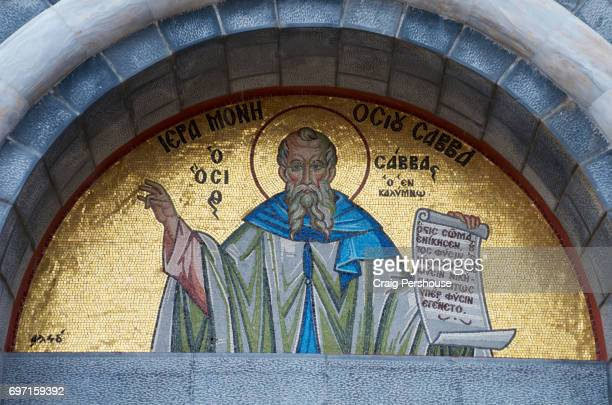 Mosaic of a saint in niche of Agios Savvas Monastery.