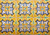 Mosaic of ancient colorful ceramic tiles with floral style