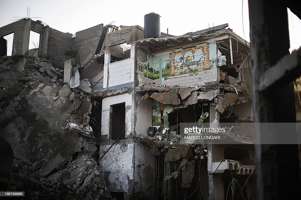 A mosaic of Jerusalem's Dome of the Rock is seen intact on a wall of a house destroyed in an Israeli airstrike on Gaza City, on November 20, 2012. Seven Palestinians were wounded in strikes on Gaza overnight, but no one was killed in the first night without fatalities since the Israeli air campaign began nearly a week ago. AFP PHOTO/MARCO LONGARI