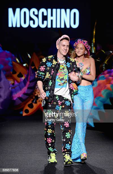 Moschino Creative Director Jeremy Scott and model Model Devon Aoki walk the runway at the Moschino Spring/Summer 17 Menswear and Women's Resort...