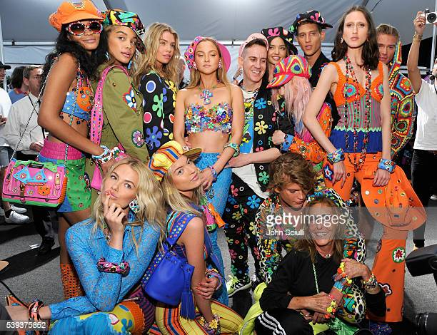 Moschino Creative Director Jeremy Scott and models pose backstage at the Moschino Spring/Summer 17 Menswear and Women's Resort Collection during MADE...