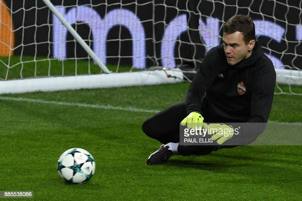 Moscow goalkeeper Igor Akinfeev attends a training session at Old Trafford in Manchester northwest England on December 4 on the eve of their UEFA...