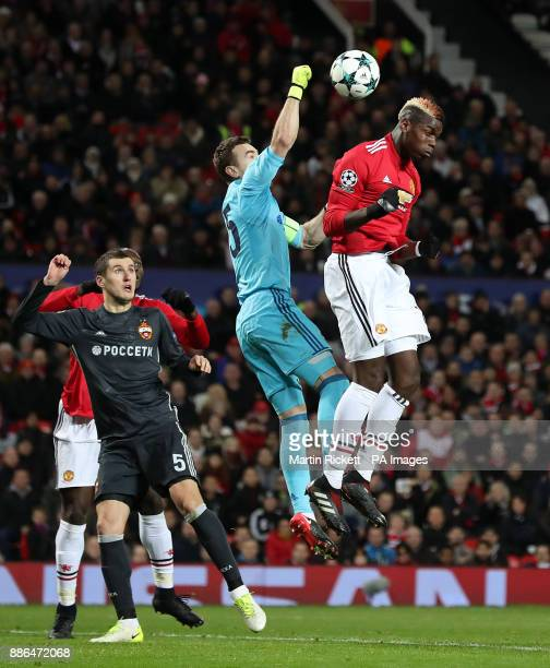 Moscow goalkeeper Igor Akinfeev punches the ball clear from Manchester United's Paul Pogba during the UEFA Champions League match at Old Trafford...