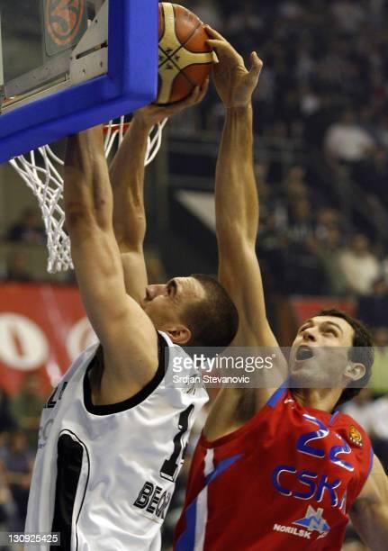 Moscow player Tomas Van Den Spiegel right blocked Nikola Pekovic left from Partizan during the TOP 16 group E Euroleague basketball match in Belgrade...