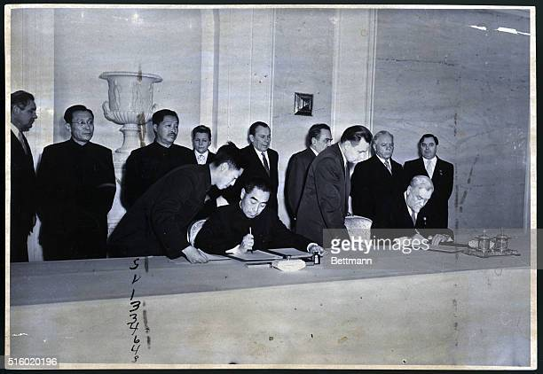 Chou EnLai and Mikolai Bulganin sign joint declaration at Kremlin Jan 18 1957 which sets forth the Communist leadership's view of the international...