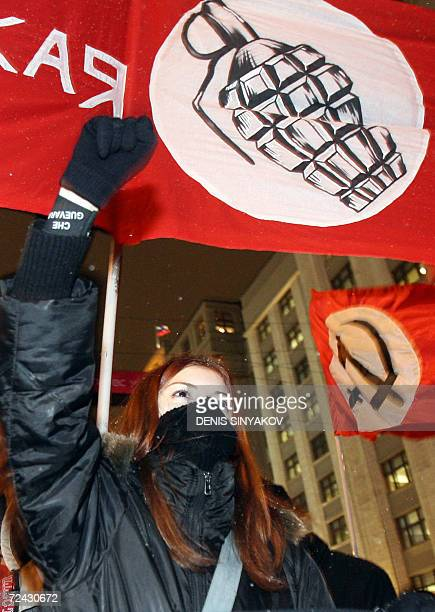 A Communist party supporter raises her fist during a rally devoted to the anniversary of the Great October revolution in Moscow 07 November 2006 The...