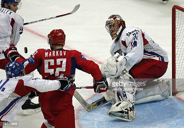 Andrey Markov of Russia scores as Czech goalkeeper Roman Cechmanek defends during a playoff round quarterfinals game of the IIHF International Ice...