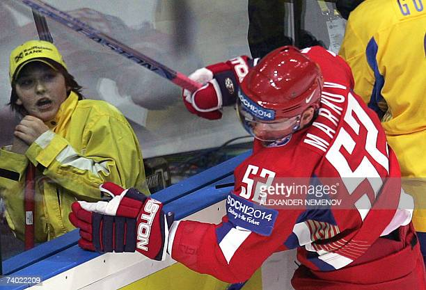 Arena staffer reacts as Russian Andrey Markov is being smashed during the preliminary round group D game of the IIHF Internetional Ice Hockey World...