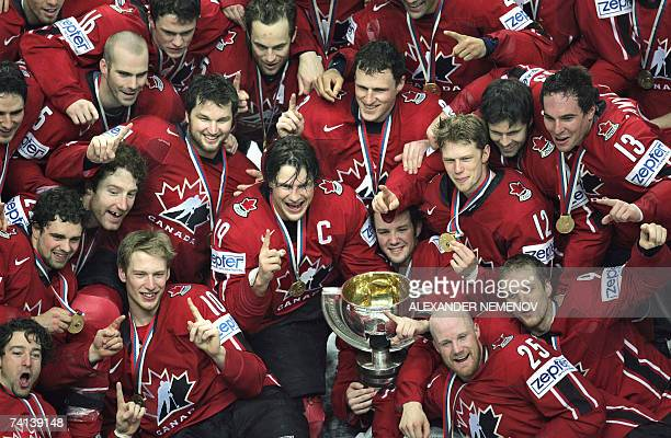 Canadian players pose with their trophy after winning the final of the IIHF International Ice Hockey World Championship against Finland in Moscow 13...