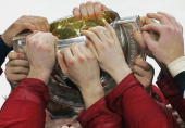 Canadian team jubilates with the trophy after defeating team Finland 42 during the final game of the IIHF International Ice Hockey World Championship...