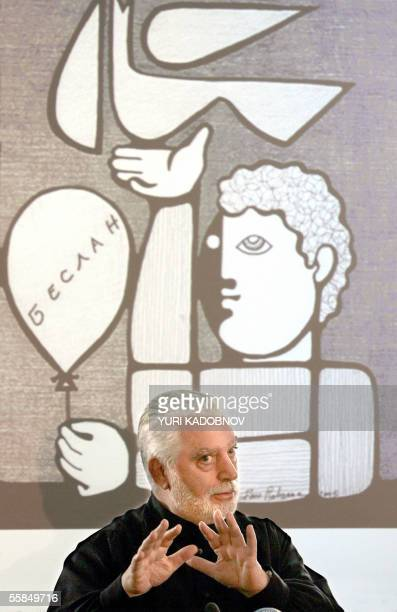 Famous French couturier Paco Rabanne gestures in front of the screen with internet reproduction of his picture devoted to Beslan's tragedy during his...