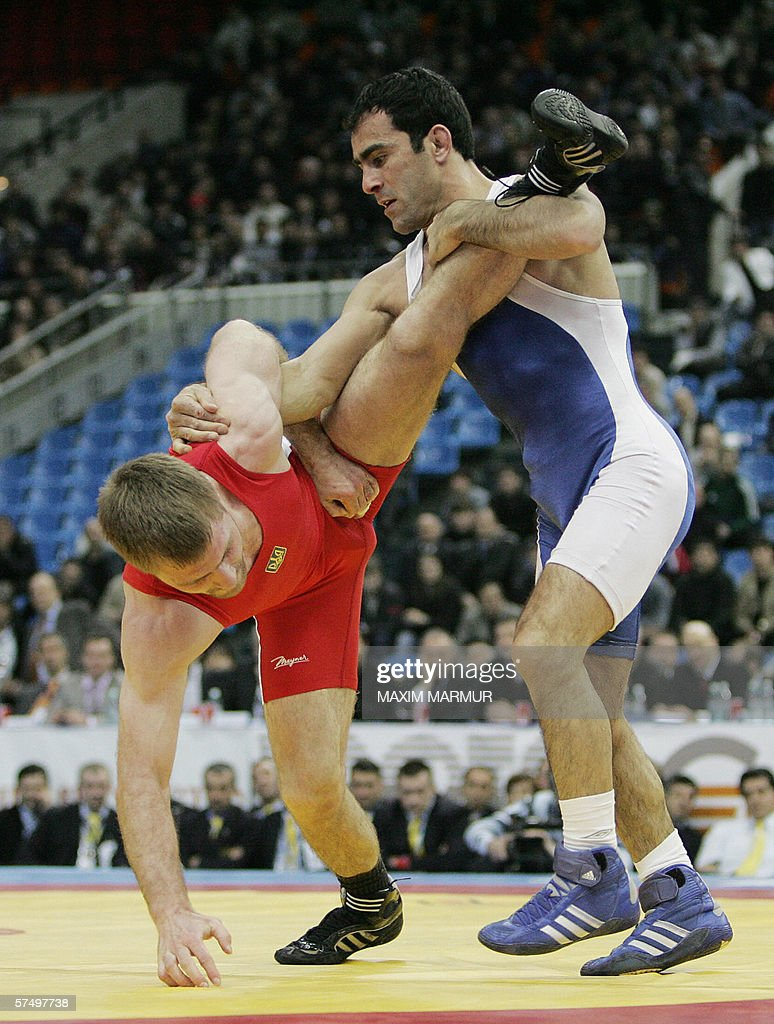 Olexander Zakharuk of Ukraine wrestles with Namig Abdullayev of Azerbaijan during the men's freestyle 55kg final in the European Wrestling...