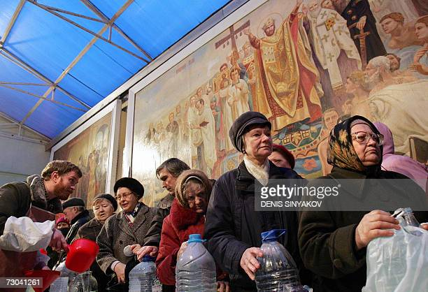 Russian believers stand in a line to get Holy Water at the Yelohovsky Cathedral in Moscow 19 January 2007 Russians celebrate Epiphany one the biggest...
