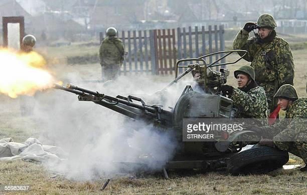 Russian interior troops soldiers shoot with an antiaircraft gun during a training in their base outside Moscow 22 October 2005 AFP PHOTO