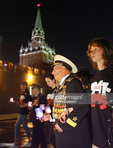 Russian veterans of WW II and young people carry candles as they approach the tomb of the Unknown Soldier near the Kremlin wall early morning 22 June...