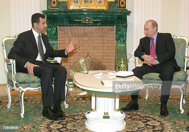 Russia's President Vladimir Putin and Syrian President Bashar alAssad talk as they meet in Moscow's Kremlin 19 December 2006 AFP PHOTO/ POOL/ SERGEI...