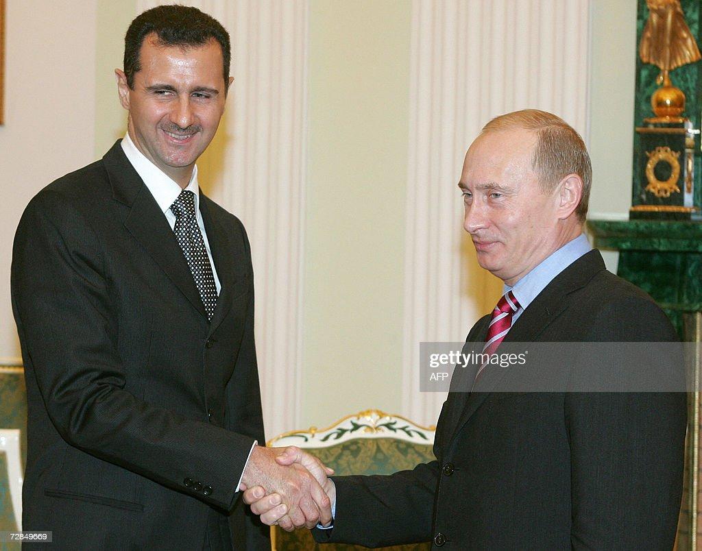 Russia's President Vladimir Putin and Syrian President Bashar alAssad shake hands as they meet in Moscow's Kremlin 19 December 2006 AFP PHOTO/ POOL/...