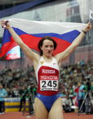 Russia's Yelena Slesarenko celebrates with her country's flag after winning the women's high jump final at the 11th IAAF World Indoor Championships...