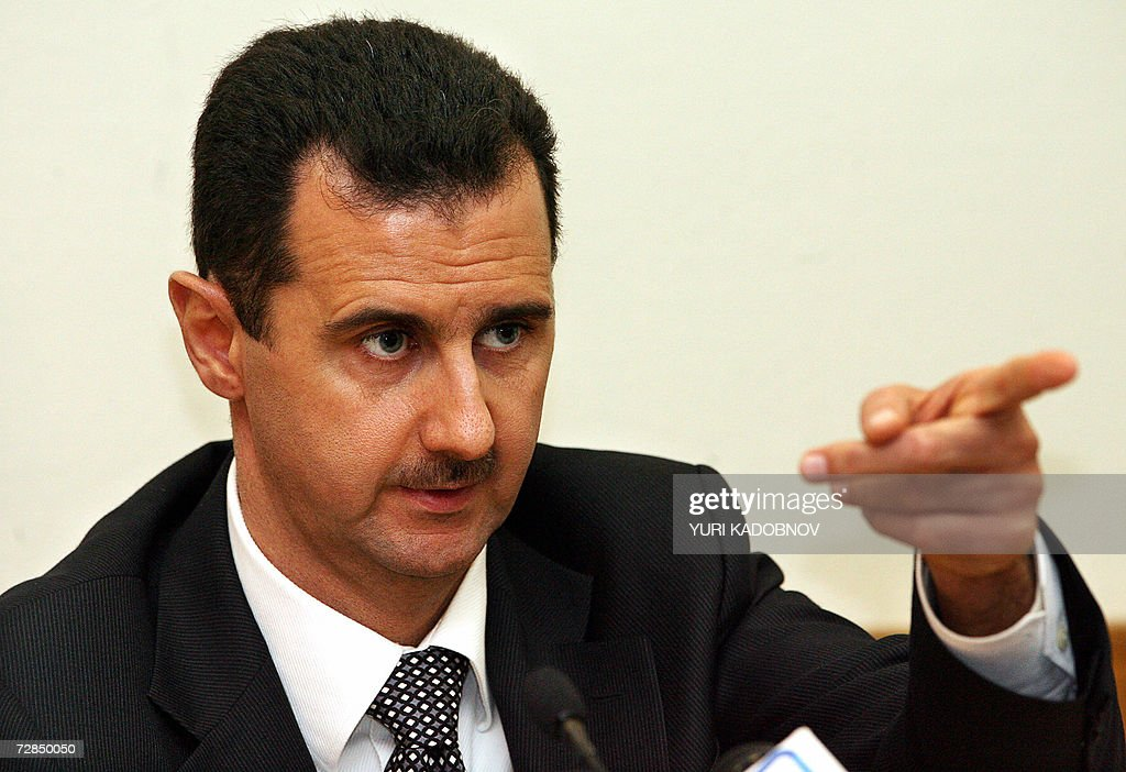 Syrian President <a gi-track='captionPersonalityLinkClicked' href=/galleries/search?phrase=Bashar+al-Assad&family=editorial&specificpeople=206274 ng-click='$event.stopPropagation()'>Bashar al-Assad</a> speaks during a press conference in Moscow 19 December 2006. Russian President Vladimir Putin and his Syrian counterpart <a gi-track='captionPersonalityLinkClicked' href=/galleries/search?phrase=Bashar+al-Assad&family=editorial&specificpeople=206274 ng-click='$event.stopPropagation()'>Bashar al-Assad</a> vowed Tuesday to cooperate in efforts to stabilise the Middle East, the Syrian leader saying he was open to dialogue with Washington but not to 'instructions'. AFP PHOTO / YURI KADOBNOV