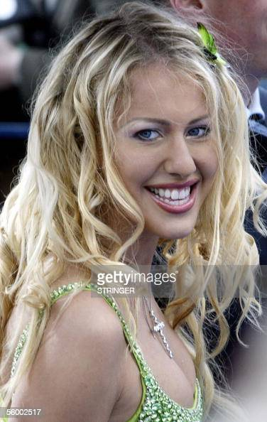 TO GO WITH AFP STORY 'Russietelevisionsociete' This picture taken 18 June 2004 shows Russian celebrity and a tv host Ksenia Sobchak arriving at the...