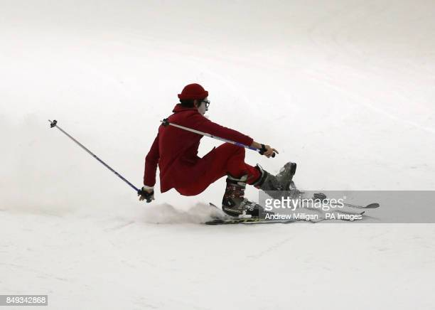 Moscow State Circus clown Pavel Ivanov falls during a photocall whilst skiing at the Snowscape at Xscape Braehead Their latest show Babushkin Sekret...