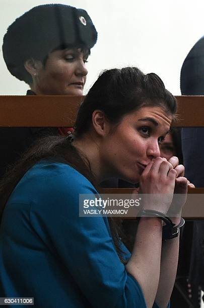 Moscow State University student Varvara Karaulova sits inside a defendants' cage during a hearing at Moscow's District Military Court on December 22...
