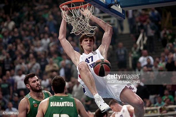 Moscow's Andrei Kirilenko scores during the Euroleague playoff basketball match between Panathinaikos and CSKA Moscow in Athens on April 20 2015 AFP...